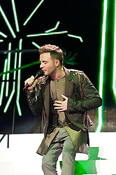 © Licensed to London News Pictures. 23/05/2012. London, UK. Westlife perform live at The O2 Arena, London, as part of their final ever farewell tour.   Westlife are an Irish boy band formed in 1998. They are to disband in 2012 after their farewell tour. The group's line-up was Shane Filan, Mark Feehily, Nicky Byrne, and Kian Egan.  In this picture - Shane Filan.  Westlife have sold over 45 million records worldwide which includes studio albums, singles, video release, and compilation albums.  Photo credit : Richard Isaac/LNP