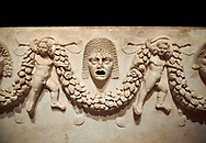 """Close up picture of Roman relief sculpted Sarcophagus of Garlands, 2nd century AD, Perge. This type of sarcophagus is described as a """"Pamphylia Type Sarcophagus"""". It is known that these sarcophagi garlanded tombs originated in Perge and manufactured in the sculptural workshops of Perge. Antalya Archaeology Museum, Turkey.  Against a black background. .<br /> <br /> If you prefer to buy from our ALAMY STOCK LIBRARY page at https://www.alamy.com/portfolio/paul-williams-funkystock/greco-roman-sculptures.html . Type -    Antalya    - into LOWER SEARCH WITHIN GALLERY box - Refine search by adding a subject, place, background colour, etc.<br /> <br /> Visit our ROMAN WORLD PHOTO COLLECTIONS for more photos to download or buy as wall art prints https://funkystock.photoshelter.com/gallery-collection/The-Romans-Art-Artefacts-Antiquities-Historic-Sites-Pictures-Images/C0000r2uLJJo9_s0"""