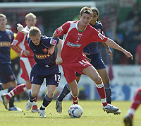 Photo: Jonathan Butler.<br /> Swindon Town v Walsall. Coca Cola League 2. 05/05/2007.<br /> Barry Corr of Swindon holds off Dean Keates of Walsall.