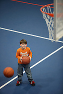 Monroe, New York - A  boy gets ready to take a shot with a basketball at the new South Orange Family YMCA on Wednesday, Feb. 16, 2011. ©Tom Bushey / The Image Works