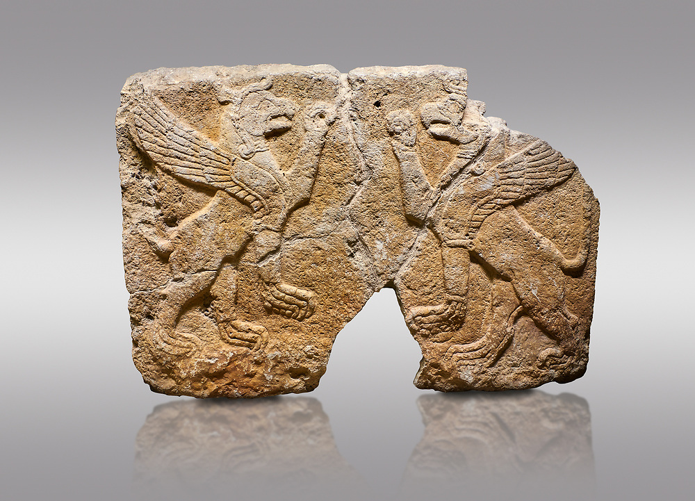Picture & image of Hittite monumental relief sculpted orthostat stone panel Orthostats of a Procession. Limestone, Karkamıs, (Kargamıs), Carchemish (Karkemish), 900 700 BC. Griffin. Anatolian Civilisations Museum. Ankara. Bird - headed lions standing opposite on their hind legs (griffin). It is symmetric. <br /> <br /> Against a gray background. .<br />  <br /> If you prefer to buy from our ALAMY STOCK LIBRARY page at https://www.alamy.com/portfolio/paul-williams-funkystock/hittite-art-antiquities.html  - Type  Karkamıs in LOWER SEARCH WITHIN GALLERY box. Refine search by adding background colour, place, museum etc.<br /> <br /> Visit our HITTITE PHOTO COLLECTIONS for more photos to download or buy as wall art prints https://funkystock.photoshelter.com/gallery-collection/The-Hittites-Art-Artefacts-Antiquities-Historic-Sites-Pictures-Images-of/C0000NUBSMhSc3Oo