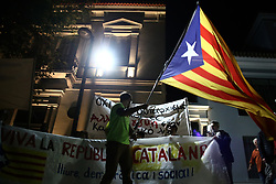 October 3, 2017 - Athens, Attika, Greece - A protester waves a Catalan separatist flag outside the Spanish embassy in Athens, on October 3rd, 2017. Leftist groups marched in central Athens in solidarity to the people of Catalonia  (Credit Image: © Panayotis Tzamaros/NurPhoto via ZUMA Press)