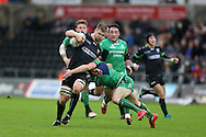 Olly Cracknell of the Ospreys © looks to get past the tackle from John Cooney of Connacht. Guinness Pro12 rugby match, Ospreys v Connacht rugby at the Liberty Stadium in Swansea, South Wales on Saturday 7th January 2017.<br /> pic by Andrew Orchard, Andrew Orchard sports photography.