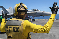 "ATLANTIC OCEAN (Aug. 7, 2018) Aviation Boatswain's Mate (Handling) 1st Class Jeremy Parrish directs an F/A-18F Super Hornet assigned to the ""Pukin' Dogs"" of Strike Fighter Squadron (VFA) 143 on the flight deck of the Nimitz-class aircraft carrier USS Abraham Lincoln (CVN 72). (U.S. Navy photo by Mass Communication Specialist 3rd Class Shane Bryan/Released)180807-N-AD724-0002"