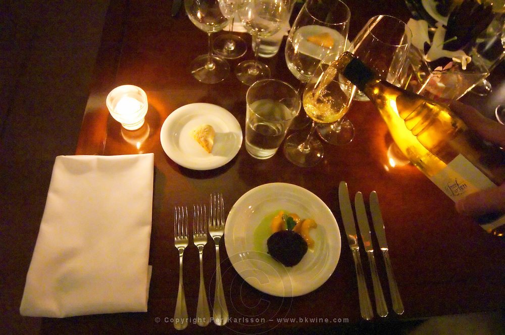 The first dish presented to the guests: fried blood sausage and fried apples, the white wine being served from the right, a Bodega Lurton The Dolly Irigoyen - famous chef and TV presenter - private restaurant, Buenos Aires Argentina, South America Espacio Dolli