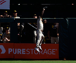 Oct 3, 2021; San Francisco, California, USA; San Diego Padres center fielder Trent Grisham (2) makes a leaping catch of a fly ball by San Francisco Giants third baseman Evan Longoria during the third inning at Oracle Park. Mandatory Credit: D. Ross Cameron-USA TODAY Sports
