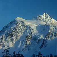 Sunset bathes Mount Shuksan in the Mount Baker Wilderness, viewed from the road to Mount Baker Ski Area.