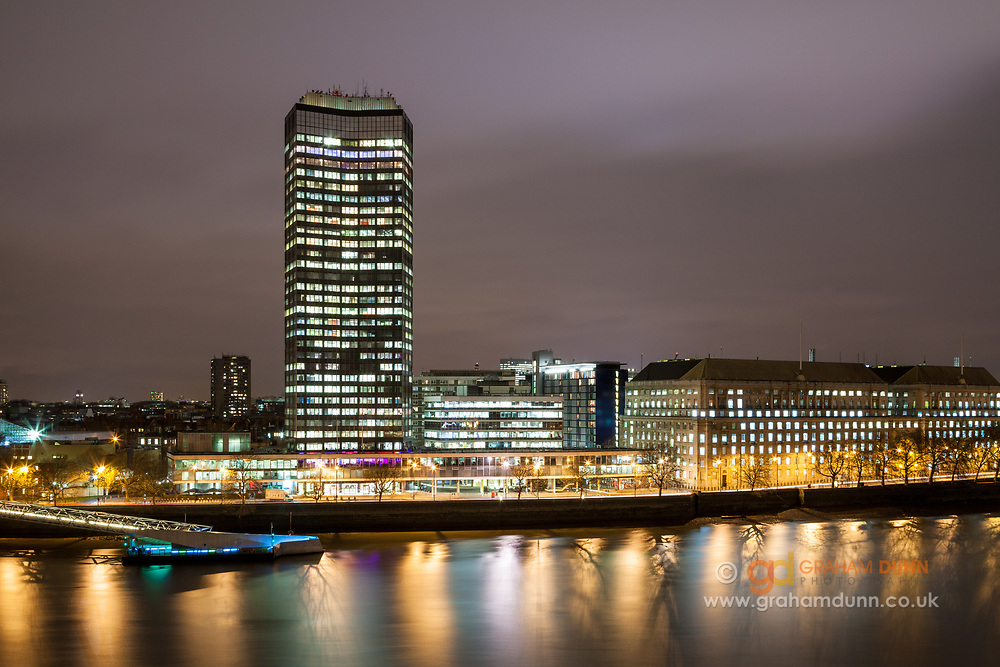 A dusk scene of Millbank with its pier, tower & surrounding buildings. Captured across the River Thames from Albert Embankment. A twilight citscape from London, England, UK.