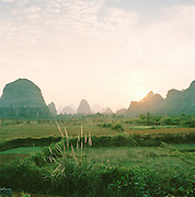 Farmland by the Karst Limestone Mountains, Guilin, Guangxi Province, China.
