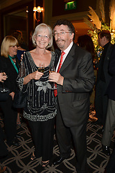ROBERT POWELL and his wife BABS POWELL at the 90th birthday party for Nicholas Parsons held at the Hyatt Churchill Hotel, Portman Square, London on 8th October 2013.