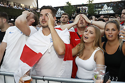 © Licensed to London News Pictures. 03/07/2018. London, UK. England football fans react to the England v Colombia game as they watch the World Cup from Russia on a giant TV screen at Boxpark, Croydon. Photo credit: Peter Macdiarmid/LNP