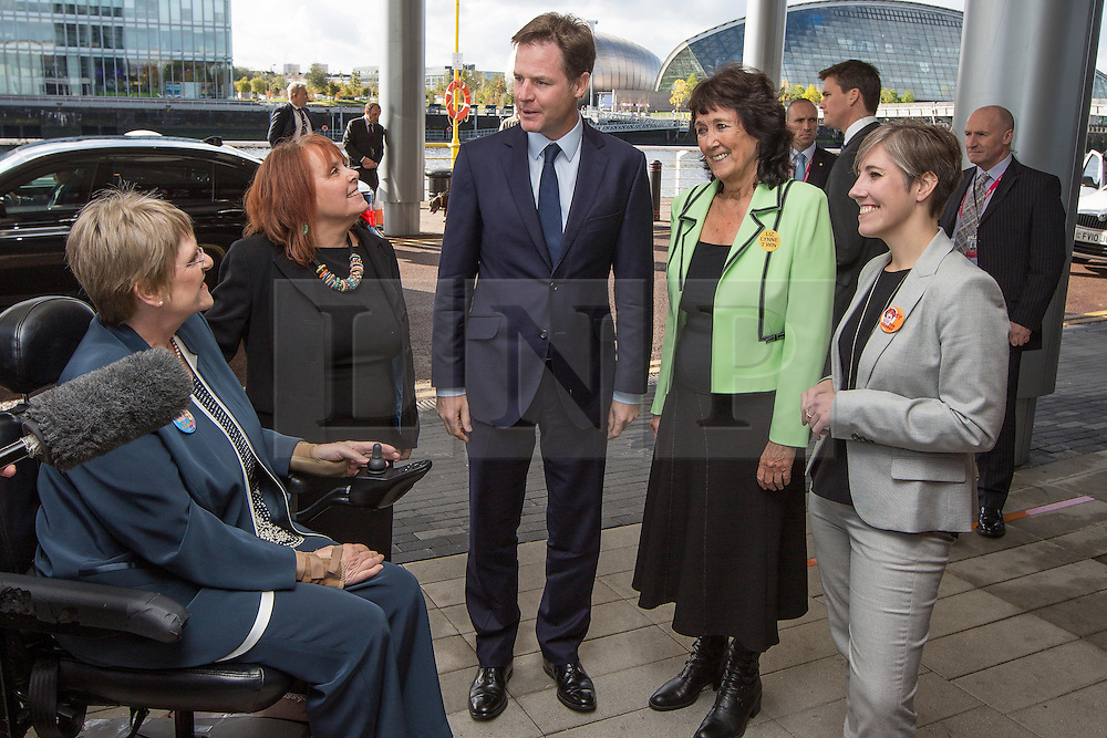 © Licensed to London News Pictures . 04/10/2014 . Glasgow , UK . Liberal Democrat leader NICK CLEGG (c) arrives and meets candidates for party president (l-r Sal Brinten , Linda Jack , Liz Lynne , Daisy Cooper ) . The Liberal Democrat Party Conference 2014 at the Scottish Exhibition and Conference Centre in Glasgow . Photo credit : Joel Goodman/LNP