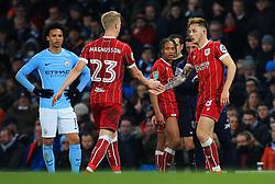 Hordur Magnusson of Bristol City is congratulated by Josh Brownhill - Mandatory by-line: Matt McNulty/JMP - 09/01/2018 - FOOTBALL - Etihad Stadium - Manchester, England - Manchester City v Bristol City - Carabao Cup Semi-Final First Leg