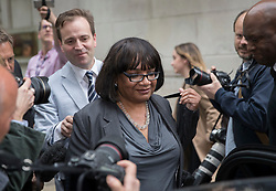 © Licensed to London News Pictures. 02/05/2017. London, UK. Shadow Home Secretary DIANE ABBOTT is surrounded by reporters as she leav Milbank Studios in Westminster, with the help of Lord Prescott's son David Prescott (behind left) after an appearance on the Daily Politics program. DIANE ABBOTT made a number of costing errors during a radio interview about  a Labour election pledge on increased policing numbers.  Photo credit: Peter Macdiarmid/LNP