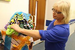 Volunteer at Mysight Nottingham dressing mannequin