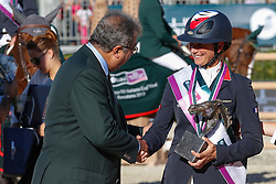 Leprevost Penelope (FRA) receiving a copy of the trophy from HRH Prince Faisal bin Abdullah bin Mohammed Al Saud <br /> Furusiyya FEI Nations Cup Jumping Final <br /> CSIO Barcelona 2013<br /> © Dirk Caremans