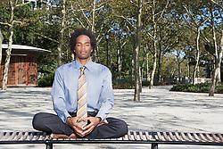 Dec. 05, 2012 - Man meditating in a park (Credit Image: © Image Source/ZUMAPRESS.com)