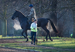 © Licensed to London News Pictures. 22/01/2021. London, UK. Steam comes off a horse as it is exercised by member of the Household Cavalry in Hyde Park, central London on a cold and frosty winter morning. Parts of the UK are currently experiencing heavy flooding caused by heavy rainfall during storm Christoph.  Photo credit: Ben Cawthra/LNP