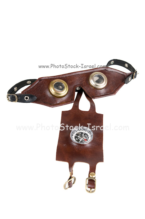Steampunk accessories flight goggles and magnetic compass On white Background