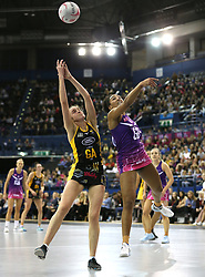 Wasps Netball's Katie Harris (left) and Loughborough Lightning's Tuaine Keenan battle for the ball during the Vitality Netball Superleague Super Ten match held at Arena Birmingham.