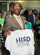 Principals display t-shirts they received as congratulations for helping the district win the Broad Prize for Urban Education during a school leadership meeting, October 2, 2013.