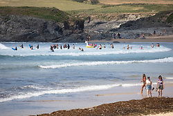 © Licensed to London News Pictures. 31/05/2020. Padstow, UK. General view of a busy Constantine Bay beach. Yesterday the RNLI reinstated their beach lifeguard service, having not provided the usual lifeguard service for this time of year in Cornwall, due to Coronavirus (COVID-19). Photo credit : Tom Nicholson/LNP