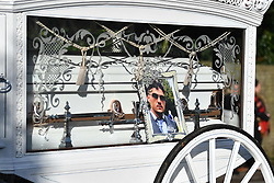 "© Licensed to London News Pictures. 13/02/2020. Sevenoaks, UK.  The coffins make their way through the town as mourners gather at St John the Baptist church in Sevenoaks, Kent for he funeral of traveller brothers Billy and Joe Smith. The twin brothers, who were made famous by the television programme ""My Big Fat Gypsy Wedding"", were found hanged in woodland three days after Christmas. Photo credit: Ben Cawthra/LNP"