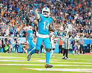 Miami Dolphins wide receiver Jarvis Landry (14) waves to the crowd after scoring on a pass reception in the third quarter as the Miami Dolphins host the Oakland Raiders at Hard Rock Stadium on Sunday, November 5, 2017.