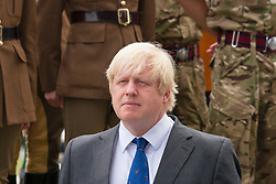 London, June 23rd 2014. Mayor Boris Johnson listens to speeches as members and veterans of the armed forces gather at City Hall for a flag raising ceremony to mark Armed Forces Day.