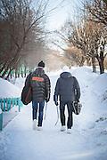 Ice Hockey players walking home in Komsomolsk-on-Amur.Siberia, Russia
