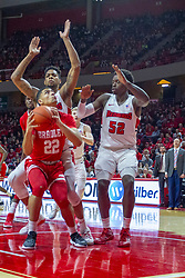 NORMAL, IL - February 16: Ja'Shon Henry hesitates to fake out defenders Phil Fayne and Malik Yarbrough during a college basketball game between the ISU Redbirds and the Bradley Braves on February 16 2019 at Redbird Arena in Normal, IL. (Photo by Alan Look)