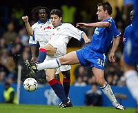 Photograph: Scott Heavey.<br /> Chelsea v Portsmouth. FA Barclaycard Premiership. 28/12/2003.<br /> Dejan Stefanovic beats john Terry to the ball