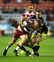 Wigan Warriors' Ryan Sutton is tackled by Wakefield Trinity's Matty Ashurst (right) during the Betfred Super League Super 8's match at the DW Stadium, Wigan.