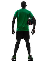 one african man soccer player green jersey rear view holding football in silhouette on white background