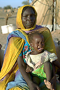 D'jimia Ishakh Souleymane, 40, and her youngest daughter, Hawa, 2. (Supporting image from the project Hungry Planet: What the World Eats.)