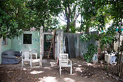 Ruins of a home ravaged by fire.  The Virgin Islands Economic Development Association Enterprise & Commercial Zone Commission hosts a historical tour through the Savan (Savanne) neighborhood.   St. Thomas, US Virgin Islands.  9 July 2015.  © Aisha-Zakiya Boyd