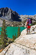 Backpacker at Second Lake under Temple Crag and the Palisades, John Muir Wilderness, California