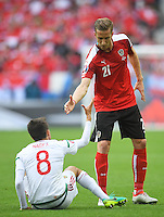 Austria's Marc Janko offers Hungary's Adam Nagy a hand<br /> <br /> Photographer Kevin Barnes/CameraSport<br /> <br /> International Football - 2016 UEFA European Championship -  Group F - Austria v Hungary - Tuesday 14th June 2016 - Stade de Bordeaux, Bordeaux, France<br /> <br /> World Copyright © 2016 CameraSport. All rights reserved. 43 Linden Ave. Countesthorpe. Leicester. England. LE8 5PG - Tel: +44 (0) 116 277 4147 - admin@camerasport.com - www.camerasport.com