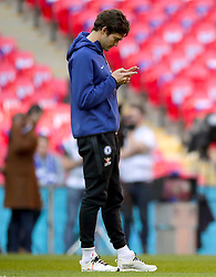 Chelsea's Marcos Alonso inspects the pitch ahead of the match
