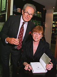 MAJ.GEN.KEN PERKINS and his wife writer CELIA SANDYS granddaughter of war time leader Winston Churchill, at a party in London on 1st July 1999.MUB 7