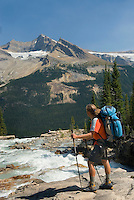 Backpacker at Twin Falls Creek with Mount Balfour in the distance, Yoho National Park British Columbia Canada