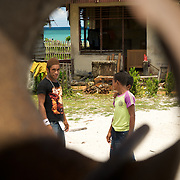 Papuan kids waiting for the gong to call for school.