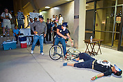 11 OCTOBER 2010 - PHOENIX, AZ: Protesters reenact the shooting of Daniel Rodriguez in front of the Phoenix police department Monday, Oct. 11. About 300 people gathered at the Phoenix Police Department headquarters building Monday night to protest the shooting of Daniel Rodriguez and his dog. The officers responded to a 911 call made by Rodriguez' mother. A scuffle ensued when they arrived and Phoenix police officer Richard Chrisman shot Rodriguez, who was unarmed, and his dog. Chrisman then allegedly filed a false report about the event. He has been arrested on felony assault charges. The event has angered some in the Latino community and they have held a series of protests at the police headquarters. They want Chrisman charged with murder.  PHOTO BY JACK KURTZ