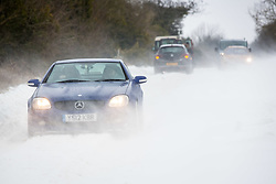 © Licensed to London News Pictures 02/03/2108, Cirencester, UK. Motorists edging through the snow drifts and strong winds along the Gloucester road between Cirencester and Gloucestser. Photo Credit : Stephen Shepherd/LNP