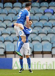 Tom Nichols of Peterborough United (bottom) celebrates scoring his sides second goal with team-mate Andrew Hughes (top) - Mandatory by-line: Joe Dent/JMP - 25/02/2017 - FOOTBALL - ABAX Stadium - Peterborough, England - Peterborough United v Rochdale - Sky Bet League One