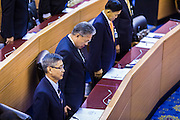 08 AUGUST 2014 - BANGKOK, THAILAND: Members of the Thai National Legislative Assembly (NLA) stand at the opening of their first meeting Friday in the Parlimanet Building in Bangkok to elect legislative leadership. The NLA was appointed by the Thai junta, formally called the National Council for Peace and Order (NCPO), and is supposed to guide Thailand back to civilian rule after a military coup overthrew the elected government in May. There are 197 members of the NLA. Membership is tilted towards military personnel. From the Royal Thai Army 40 members are Generals, 21 are Lt. Generals and 7 are Major Generals. From the Royal Thai Air Force 17 are Air Chief Marshals and 2 are Air Marshals. From the Royal Thai Navy, 14 are Admirals and 5 are Vice Admirals. There are also 6 Police Generals and 3 Police Lt. Generals. There are 187 men in the NLA and only 10 women.        PHOTO BY JACK KURTZ