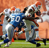 MORNING JOURNAL/DAVID RICHARD.Cleveland running back Reuben Droughns tries to leap past the Detroit defense yesterday.