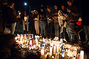 A vigil for Roderick Travon Godfrey and Deante Antonio Miller is attended by their friends and family, Tuesday, Nov. 29, 2016 in Oakland, Calif. Godfrey and Miller, both 19 years old, were killed yesterday morning when they were both shot multiple times on the 700 block of 39th Street, between West Street and Martin Luther King Jr. Way, police said. No suspect was identified or arrested in the killings.