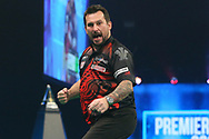 Jonny Clayton hits a 180 and celebrates during the PDC Unibet Premier League darts at Marshall Arena, Milton Keynes, United Kingdom on 28 May 2021.