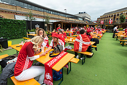 © Licensed to London News Pictures. 07/07/2021. LONDON, UK.  Denmark football fans gather in Vinegar Yard, Bermondsey, ahead of the Euro 2020 semi-final between England and Denmark at Wembley Stadium.  Photo credit: Stephen Chung/LNP